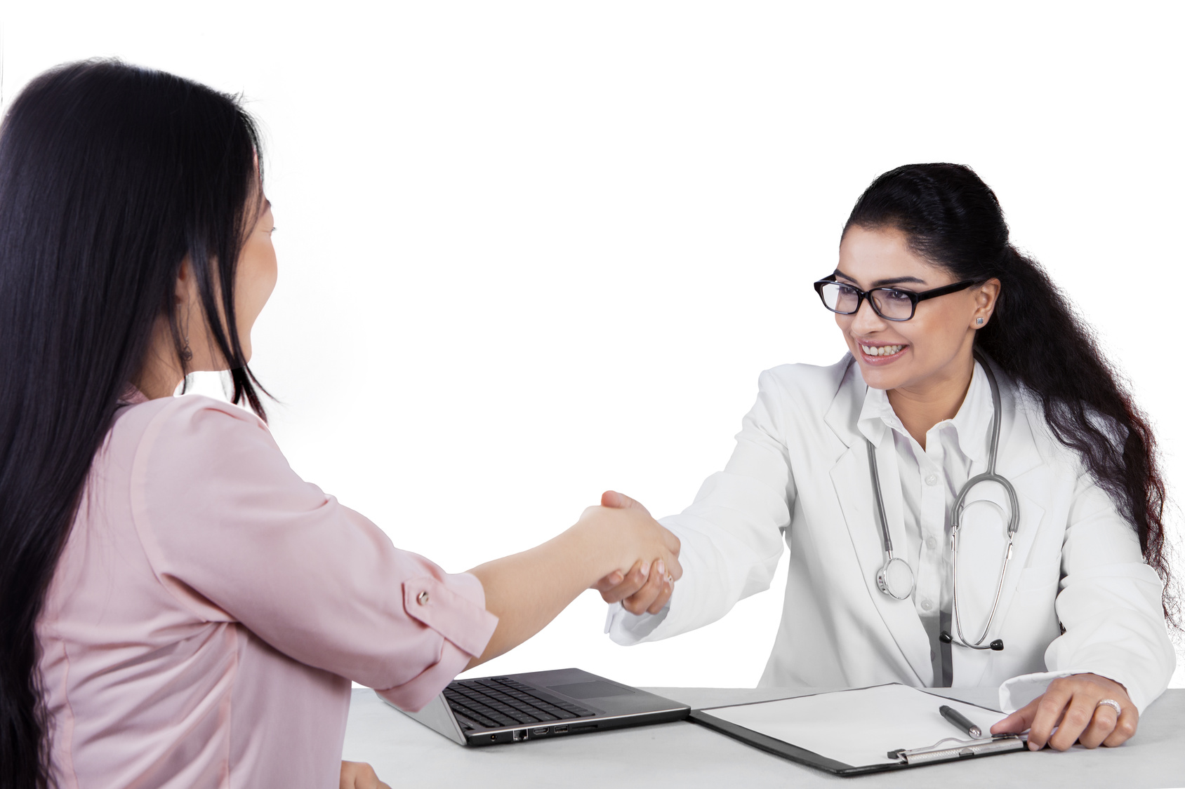 doctor and patient shaking hands and smiling