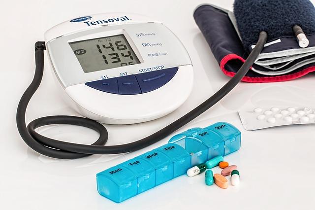 Blood pressure cuff and pills