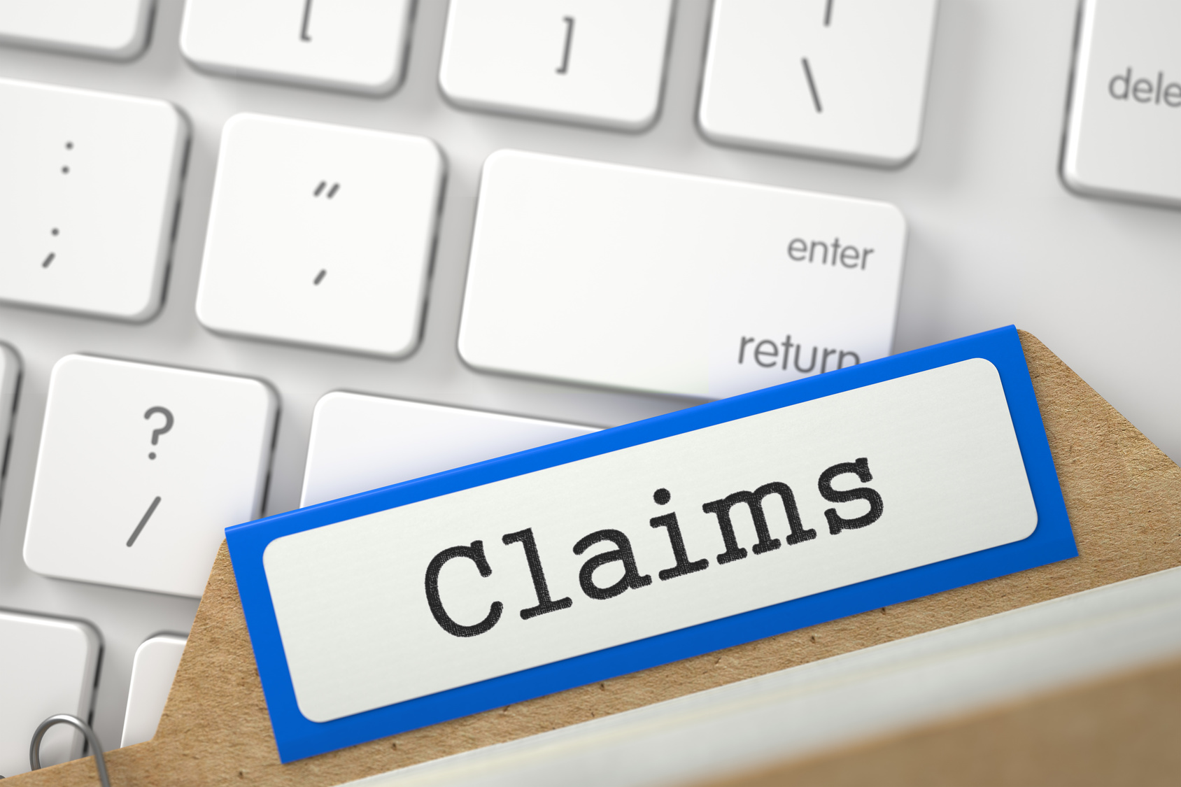 "File folder marked ""Claims"" in front of computer keyboard"