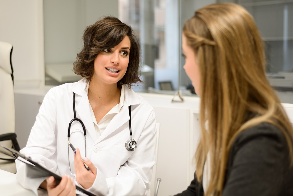 Doctor talking to young patient