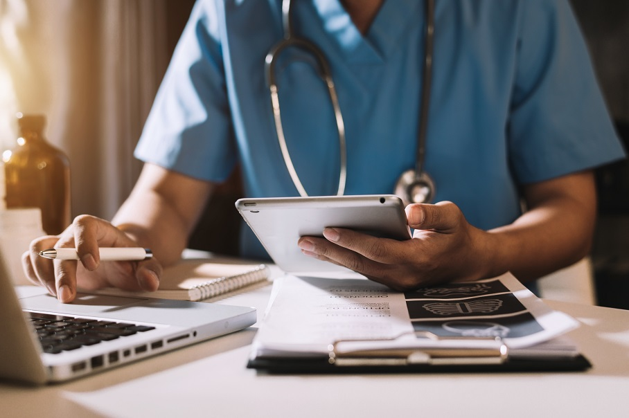 Doctor working with mobile phone and stethoscope