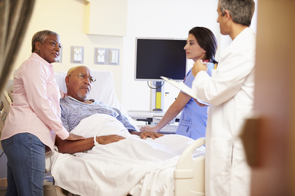 Man and woman in hospital talking to doctor and nurse