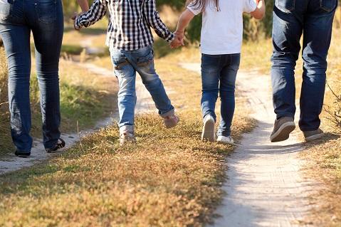 Family walking on dirt path