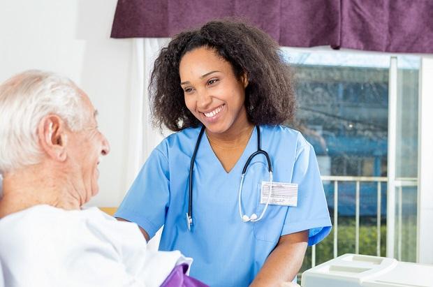 Nurse caring for man in hospital