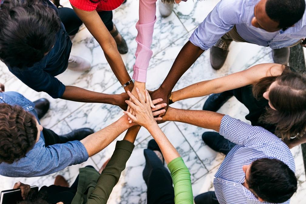 Team puts hands together