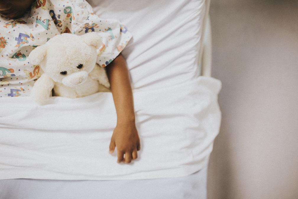 Little girl sleeping hospital bed