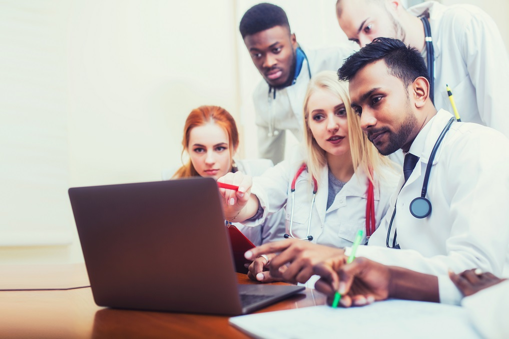 Medical students in front of laptop