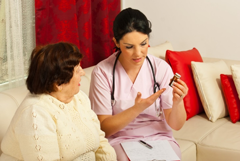Nurse explaining medications to patient