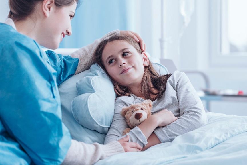 Smiling caregiver visiting sick child
